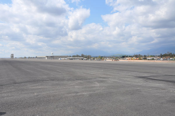 The Air Force applied a protective soil cap to the former landfill, approximately 20 acres large, as part of the cleanup at the former Norton Air Force Base. Later the site was paved by the Local Redevelopment Authority for use as a parking lot