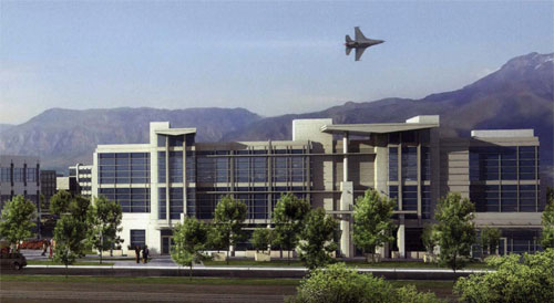 Image of building with aircraft overhead at Hill AFB
